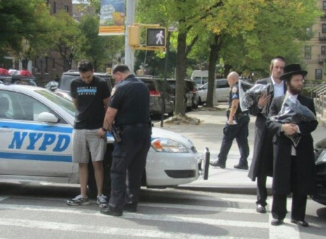 Activist Arrested (photo: Yeshiva World News)