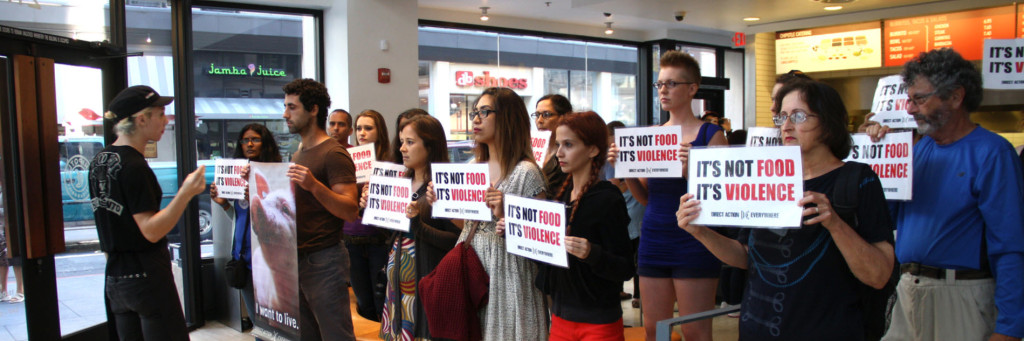DxE protests Chipotle's for marketing animal farming & slaughter as humane.
