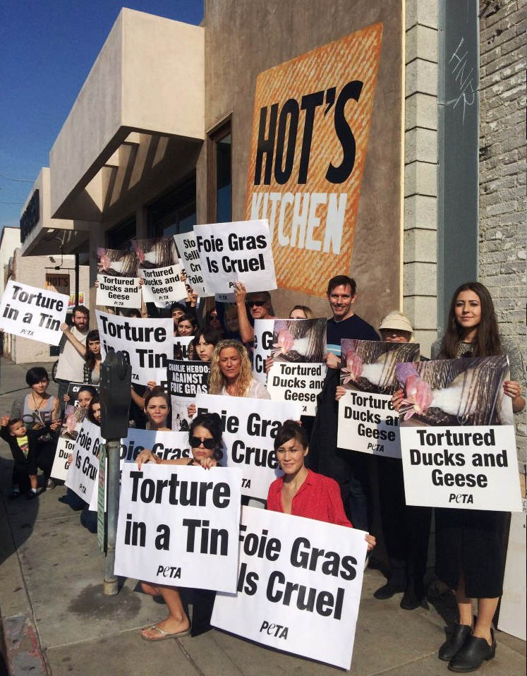 Activists with PETA protest the return of foie gras in California (photo: PETA)
