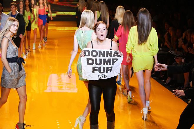 Protesting at a Donna Karan runway show