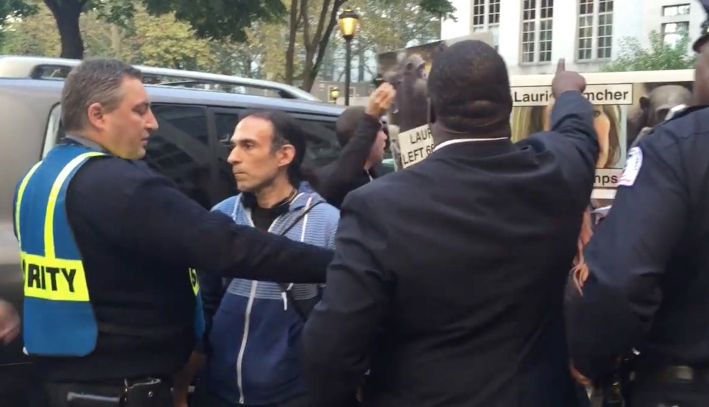 Cornell security guards block activists from protesting on a public sidewalk