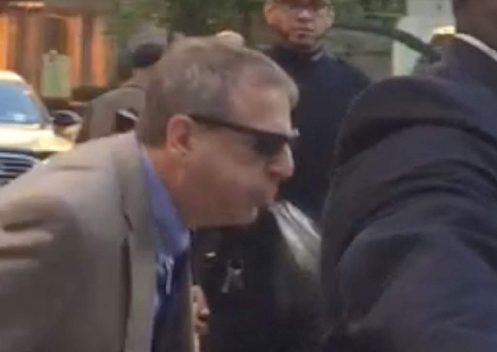 A man exiting Cornell spits on an activist protesting Dr. Laurie Glimcher