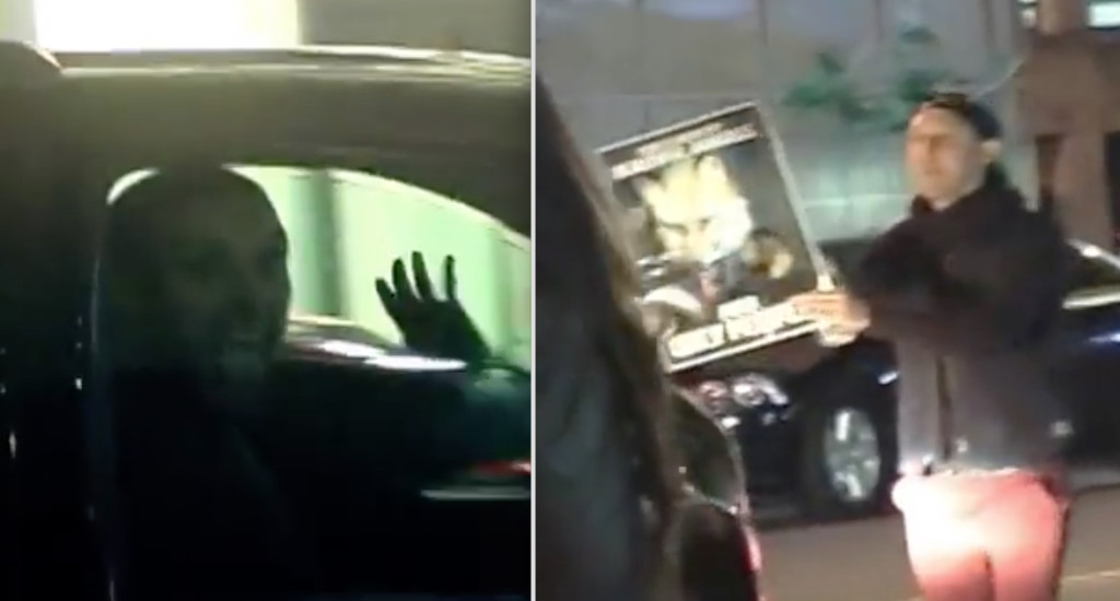A member of Amber Rose' entourage sticks his tongue out activists as her SUV leaves Barnes & Noble