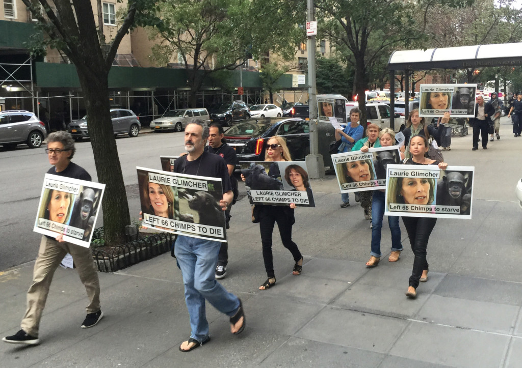Activists march from Laurie Glimcher's office to her home in NYC