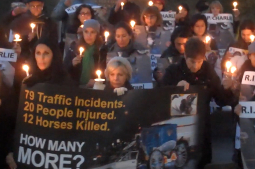 Activists in NYC stage protest to demand that Mayor Bill de Blasio fulfills his promise to ban horse-drawn carriages