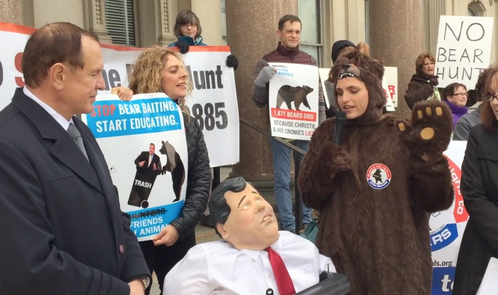 From left to right: NJ State Senator Raymond Lesniak, a dummy of NJ Governor Chris Christie in a bear-proof garbage can, Friends of Animals' Edita Birnkrant