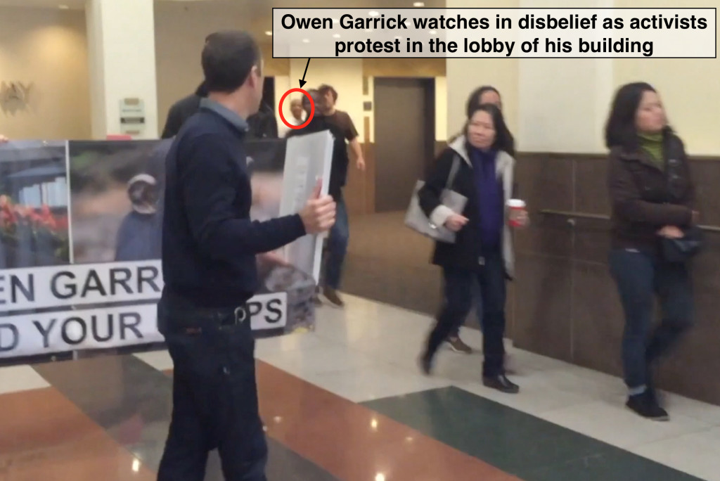 Owen Garrick paced back and forth as activists protested in the lobby