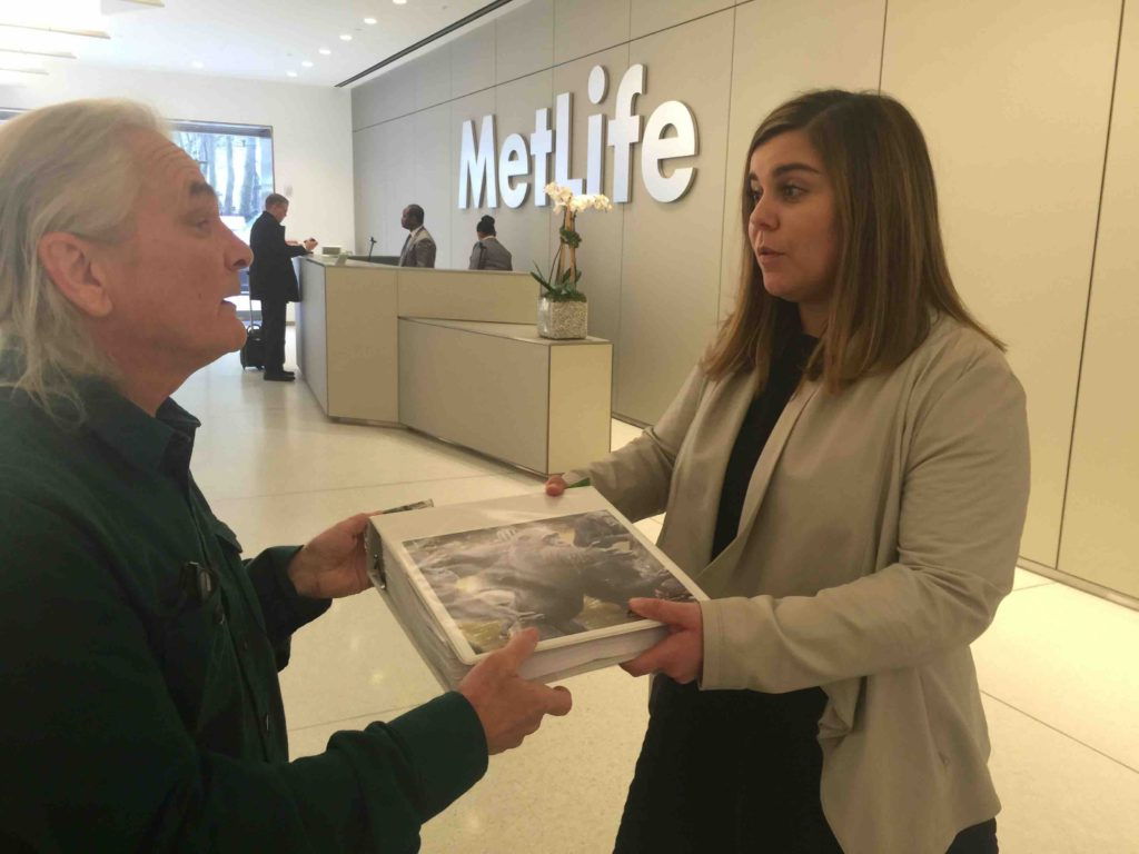 Primatologist Bob Ingersoll delivers petition to MetLife, asking company to cut funding to New York Blood Center