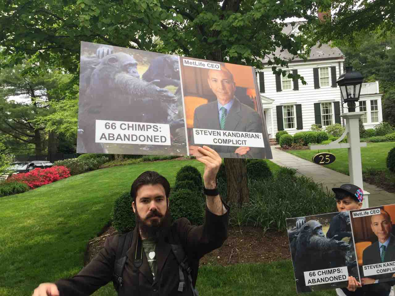 Activists protest at the Summit NJ home of Steven Kandarian.